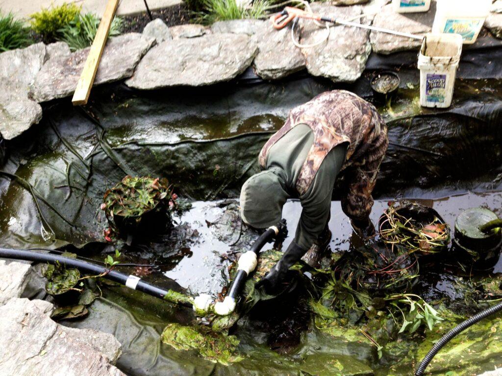 crew-installing-backyard-pond