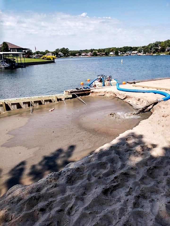 pumping-sand-back-in-beach-seawall